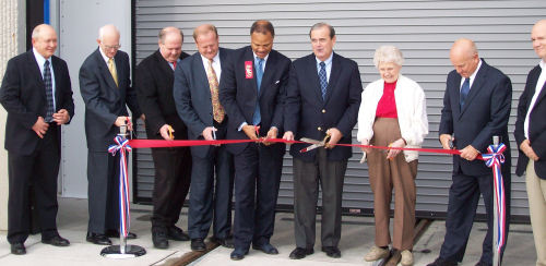 Cutting the ribbon: Rep. Tom Holbrook, St. Clair County Board Chairman Mike Kern, ---, Congressman Jerry Costello, St. Clair County Transit District Chair Dolores Lysakowski