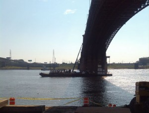 A barge and man-lift on the Mississippi River