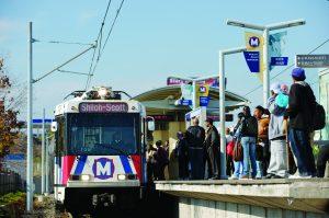 Passengers at the North Hanley MetroLink station on November 23, 2009.
