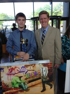 First Place High School Artist Michael Holdman and St Clair County State's Attorney Brendan Kelly