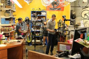 Technicians at work at Urban Shark and the Downtown Bicycle Station.