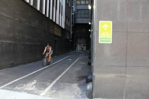 A cyclist departs the Downtown Bicycly Station.
