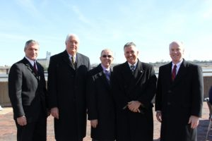 Nations and other project partners pose for a photo on the riverfront.