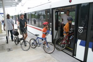 Family Boarding MetroLink with bikes