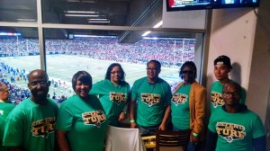 Metro employees volunteered with the Rams' Green Team and helped recycle at a game last fall.