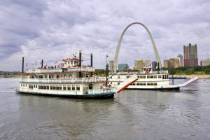 both riverboats in front of arch