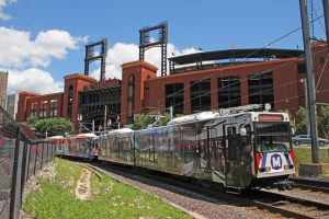 20th anniv train departing with stadium in background