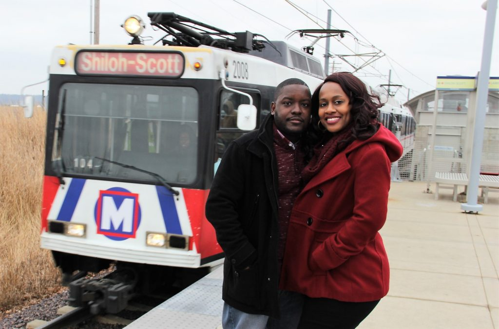 couple in front of MetroLink train