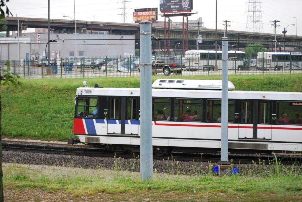 metro lines train near parking lot