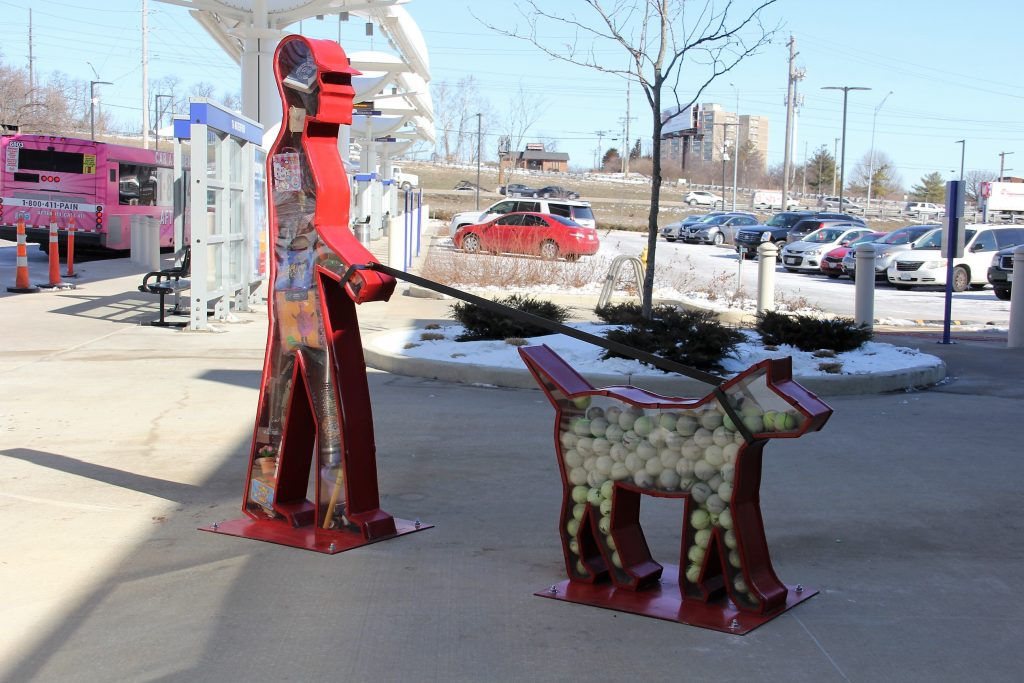 Art work showing person walking dog.