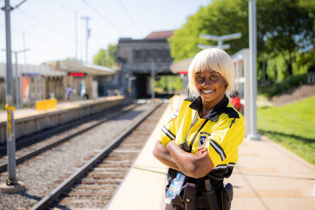 Image of security team member Erica standing on the Delmar MetroLink platform