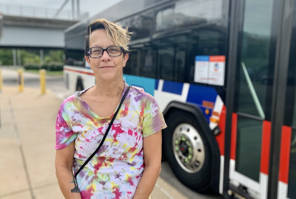 Image of passenger Lisa in front of a MetroBus
