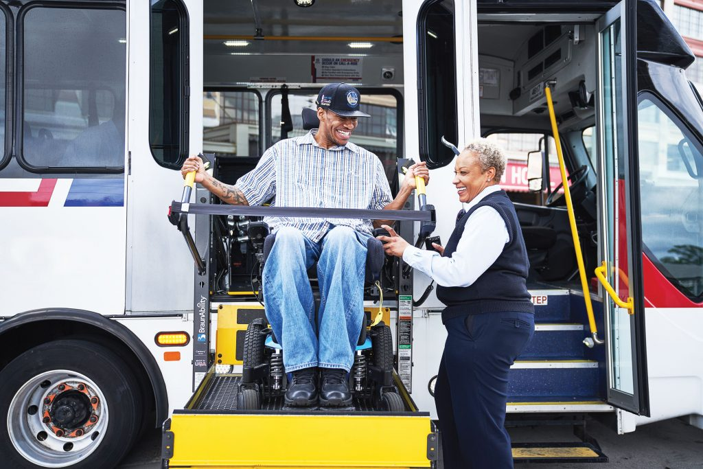 Metro Call-A-Ride operator helping man on the wheelchair lift