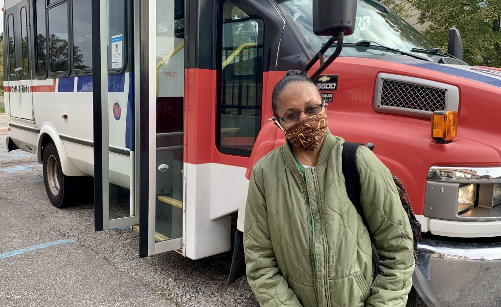 Passenger Profile: Roshonda standing in front of a Metro Call-A-Ride van