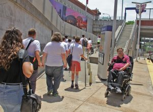 Man in a wheelchair at the Stadium MetroLink Station