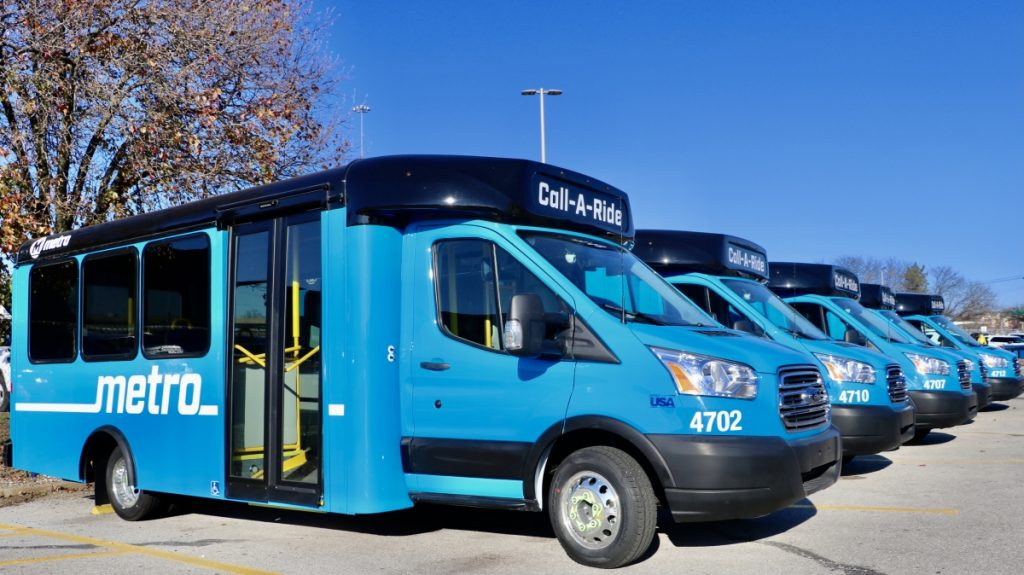 New Metro blue Call-A-Ride vans shown lined up side by side