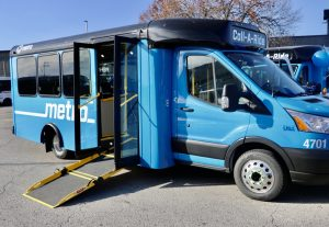 New Metro blue Call-A-Ride vans shown with the ramp down