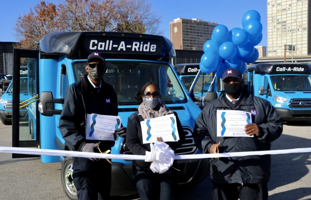2020 Call-A-Ride Operators of the year standing in front of the new Call-A-Ride vans, holding their certificates. From left to right: Jerome, Barbara, Howell