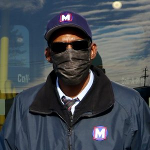 Metro Call-A-Ride 2020 Operator of the Year Jerome, smiling at the camera and holding his certificate of achievement