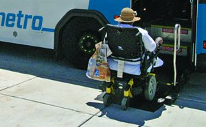 MetroBus passenger in a wheelchair boarding at the front of the bus