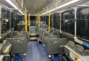 Interior shot of a MetroBus with gray seats