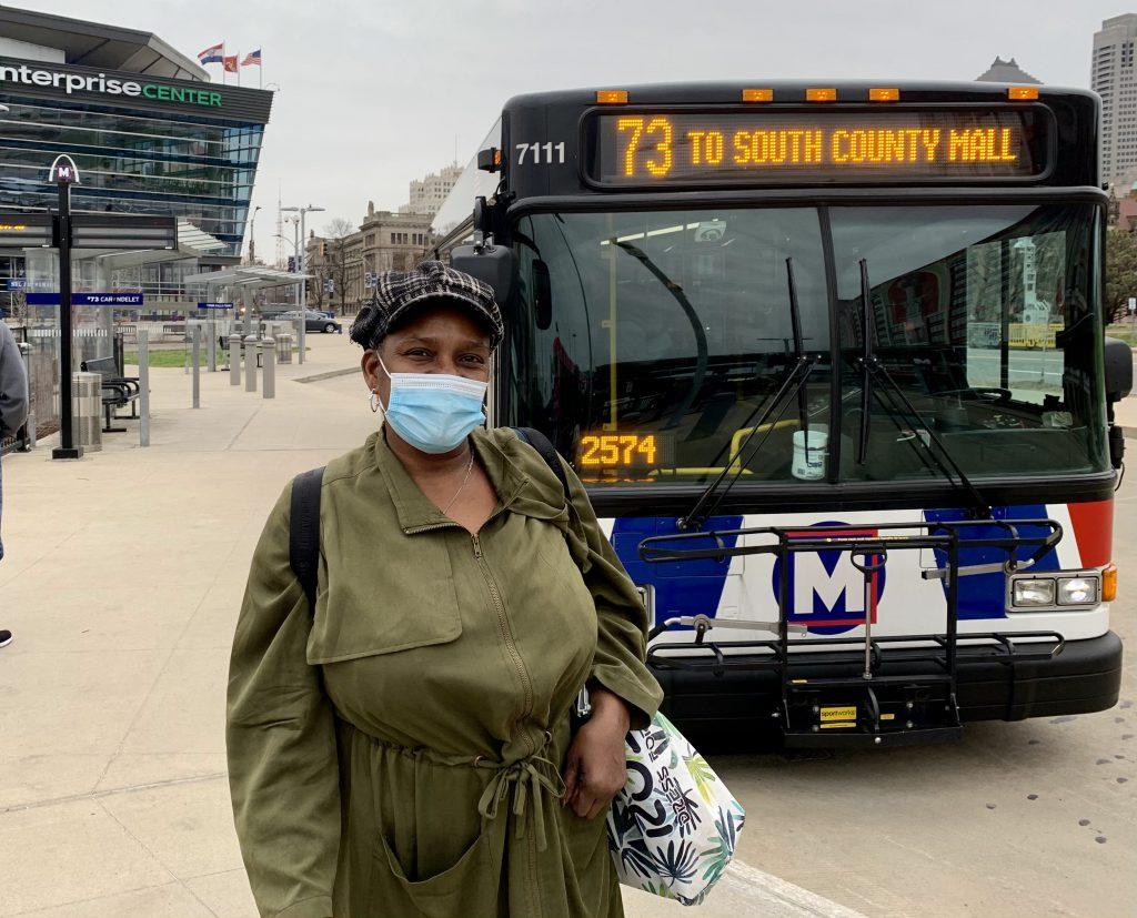 Image of passenger Vickie standing in front of a #73 bus at Civic Center Transit Center