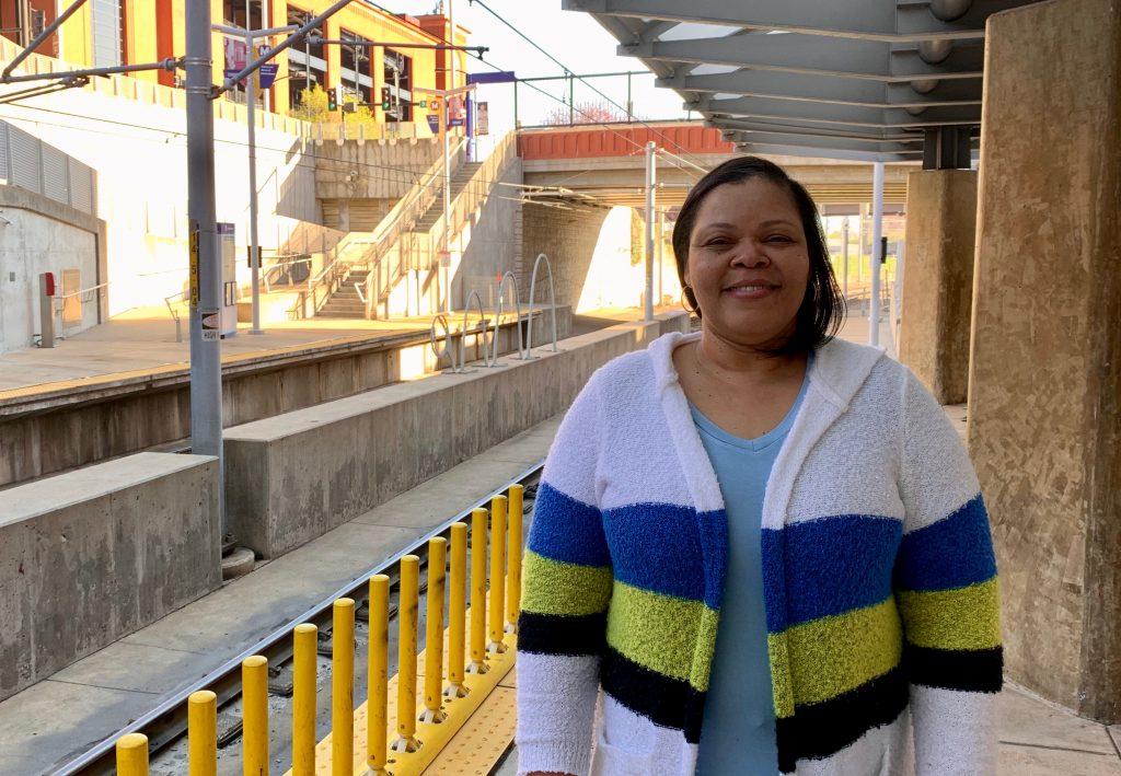 Passenger Nicole standing on the platform at the Stadium MetroLink Station