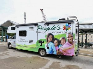 Image showing a Betty Jean Kerr People's Health Centers Mobile Health Screening van at a Metro Transit Center